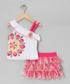 This flower-festooned pairing is ready to rule the playground with a charming asymmetrical cut and tiers of frilly ruffles. A soft cotton blend means these treats are just as comfy as they are cute.