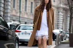 ELLE.com photographer Tyler Joe captures the chicest street style moments from Milan Fashion Week.