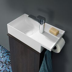 Perfect for your guest bathroom: Burgbad Yumo washbasin with integrated WC paper and towel holder. Design by nexus product design