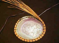 Agate with pine needles attached, using the invisible stitch