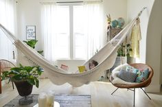I kind of absolutely love this idea of a hammock indoors. A sunroom would be amazing with this!! Perfect place to read or take a nap!
