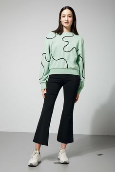 The Hidden Sweatshirt charms with its abstract geometrical shape created by  dimensional tape details. This
