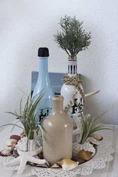 I love it when decorating is easy, and simple. Some pretty wine bottles from the grocery store inspired this super easy, and pretty summer beach decor.  www.songbirdblog.com