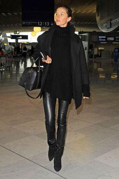 Gisele Bundchen black leather leggings, sweater, and coat