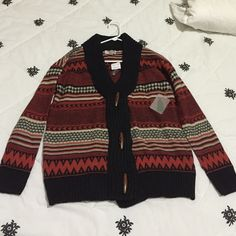 Sweater cardigan Orange and black cardigan with brown buttons. Brand new, never worn and super comfy! Forever 21 Sweaters Cardigans