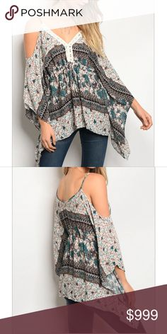 "COLD SHOULDER ❤️LISTING FOR ARRIVAL NOTIFICATION❤️ STYLISH IVORY / TEAL TOP FEATURES MULTI FLORAL PRINT, LONG SLEEVES,  V-NECK,  COLD SHOULDERS, FLATTERING TUNIC FIT RAYON SMALL B: 38"" L: 27"" W: 38"" Tops"