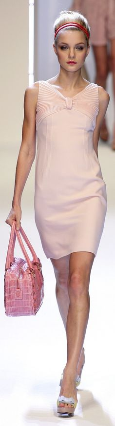 Valentino-simple sheath dress where the beautiful fabric and color are the stars. Timeless fashion.