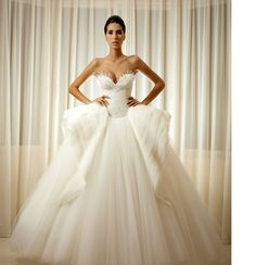 Loving this winged ball gown by Moe Shour! The detailing at the top... #gorgeous #weddings #weddingdress #bride #knotsandconfetti