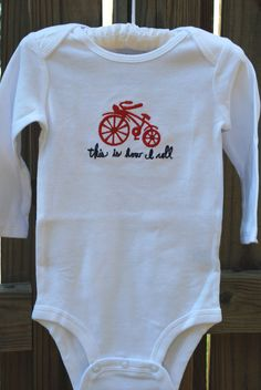 Bicycle baby bodysuit/onesie embroidered 'this is how i roll'. $15.00, via Etsy.