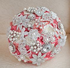 Brooch bouquet. Deposit on a Coral, Ivory and Silver wedding brooch bouquet