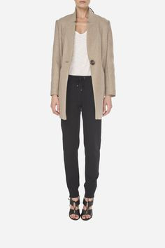 18 Woolen jacket - 1400zł (350€), Cotton sweatpants - 380zł (95€)