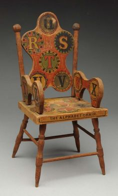 "ABC doll chair. All wood with paper covering marked ""The Alphabet Chair Patent applied for Forbes Co. Boston.""."