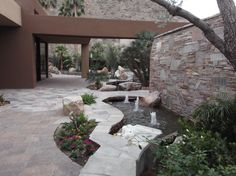 Front Walkway.  The path along the house is done in pavers; the walk from the street, around the waterwall, to the front door is paved in quartzite.