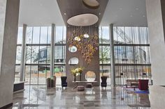 A landmark hotel at Wembley Stadium, Hilton is within easy reach of London's West End. Modern meeting space, indoor pool, Sky Bar, sauna and steam rooms. Public Hotel, Wembley Stadium, Wembley Arena, Landmark Hotel, London Hotels, Light Project, Glass Chandelier, Hotel Lobby, Stars