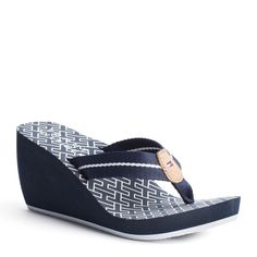 Fashion meets casual beach style with these wedge flip flops. Broad polyester strap with sleek stripe and Tommy Hilfiger flag on the leather patch at the centre. EVA foam insock and heel for a soft, cushioned feel. Initial print all over the insock, logo at the heel. Rubber outsole.