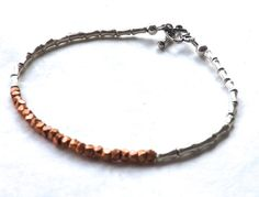 Hey, I found this really awesome Etsy listing at https://www.etsy.com/listing/190152215/eclectic-copper-and-silver-bracelet