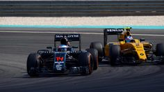 Fernando Alonso (ESP) McLaren MP4-31 and Jolyon Palmer (GBR) Renault Sport F1 Team RS16 battle at Formula One World Championship, Rd16, Malaysian Grand Prix, Race,  Sepang, Malaysia, Sunday 2 October 2016. © Sutton Images