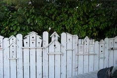 Love this unique birdhouse fence which adds #rustic charm. www.homestylingstaging.com