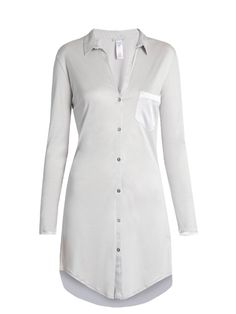Hanro's nightwear is defined by effortless elegance and indulgent comfort. This silvery grey Grand Central nightdress is cut from a modal and silk-blend jersey for a luxuriously soft feel, and designed with an open point collar and a thigh-skimming curved hem. Lustrous satin trims complete the look.