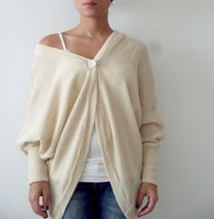 Oversize knitted cardigan with loose bat wings sleeves.  This knitted cardigan is great for layering over tank top, blouse or a dress.  You can wear it open