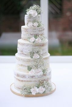 semi iced with buttercream I like how the flowers tumble down... click though aswell there are two other really nice ones one with autumn fruits and one with lavender- i cant seem to pin them on this PC