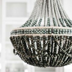 As Shown: Ombré African Wooden Bead Chandelier Size: 24 dia x 27 H inches Material: Wooden Beads