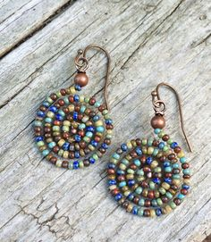 Colorful Boho Spiral Beaded Earrings by Lammergeier on Etsy https://www.etsy.com/listing/238269730/colorful-boho-spiral-beaded-earrings