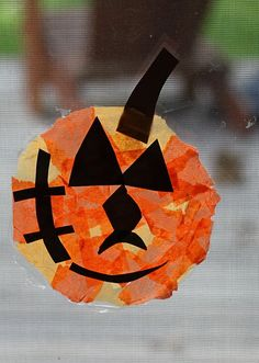 DIY Stained Glass Pumpkins craft -- school glue, paint brush, plastic plate, tissue paper