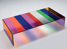 Piero Lissoni's kaleidoscope-like, colored glass coffee table