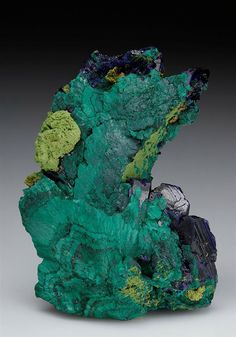 This specimen is a good example of the pseudomorphing process between Azurite and Malachite.