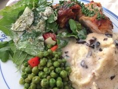 Saturday night feast! Brined rotisserie chicken with fresh chimichurri, buttered peas, potatoes mashed with Boursin cheese and mushroom gravy on top, and a fresh garden salad with homemade ranch.