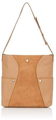 c85d2e2f296 Halston Heritage s large hobo bag is crafted of tan pebbled leather  detailed with central panels of tan suede.