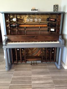 Piano bar created by Jim Lessard. Solid walnut inserts and wine racks. Wine Rack Wall, Wine Racks, Piano Crafts, Painted Pianos, Old Pianos, Piano Bar, Upright Piano, Piano Room, Front Rooms