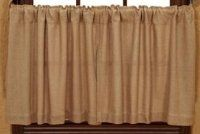 """Burlap Natural Tier - Set of 2 by Nancy's Nook. $23.95. 100% Cotton Fabric. Burlap Natural 36"""" Curtain Tiers 72"""" Wide x 36"""" Long Priced and sold as a set of 2. Unlined. 1/2"""" header with a 3"""" rod pocket. Designed and manufactured by Victorian Heart."""