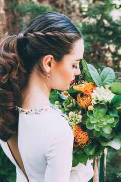 braided bridal hair - photo by Indestructible Factory http://ruffledblog.com/tropical-mid-century-modern-wedding-inspiration-with-spanish-flair