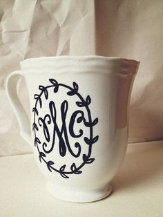 monogram dollar tree mugs & a sharpie. just use a sharpie to draw your pattern and monogram then put in the oven @ 350 for 30 mins to seal!