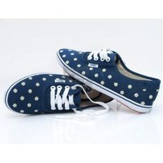 White polka-dotted navy blue VANS. These are super cute