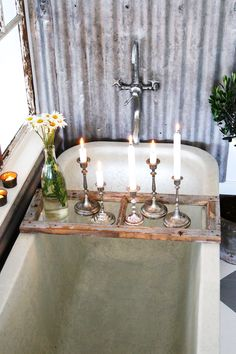 Rustic bathroom - love the old window pane come tub table. Simply gorgeous.