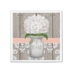 Pretty rustic style monogrammed mason jar napkins with white hydrangea flowers and a wooden fence, nail head and antique damask pattern lace background and stitched cornflower pale peach washed light coral hued ribbon. These paper napkins can be personalized with the initials and monogram of the bride and groom on the mason jar. These invites are perfect for a country chic, western, farmhouse, farm, barn, western, garden party or barnyard style wedding, anniversary party, engagement dinner…