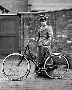 Girl with new bike, 1890s
