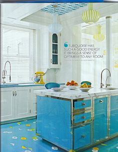 love the white cabinets and blue island!