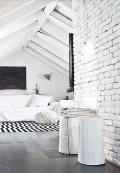 whitewash brick & beam loft bedroom