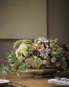 Fall Flower Arrangement with Hydrangeas, Queen Anne's Lace, round star scabiosa, fuzzy foxtail grass, and spiked sea holly in a floral foam dome of sedum flowers filling a shallow pewter dish. Thanksgiving Flowers, Thanksgiving Centerpieces, Autumn Centerpieces, Thanksgiving Table, Autumn Decorations, Christmas Tables, Centerpiece Ideas, Holiday Tables, Floral Centerpieces