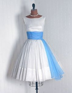 girls in white dresses with blue satin sashes. (sing with me!)  Reminds me of a 50s wedding dress - I LOVE this!