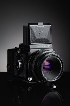https://flic.kr/p/pVkYLk   Bronica ETR   Test Image - started working on a camera project _ Bronica ETR Waist-Level Finder (WLF) 75mm f/2.8 PE Lens 120/FIlm Back _ Camera Portrait Project