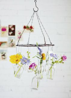 DIY Wire And Glass Bottle Hanging Flower Chandelier   Thanks, Sweet Paul!