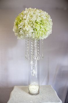 Genuis those green foam balls with artificial flowers as diy wedding centerpiece using silk flowers and chandelier hanging crystals from crystal prism world junglespirit Image collections