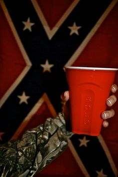 red solo cup I like to fill you up Lets have a party I love you red solo cup I lift you up LOL lyrics by Toby Keith :D