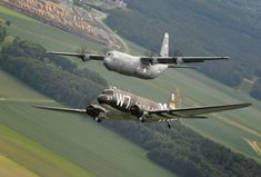 A World War II-era Douglas C-47 Skytrain (foreground), known as Whiskey 7, flies alongside a C-130J Super Hercules from the 37th Airlift Squadron over Germany, May 30, 2014. The C-47 came to Ramstein Air Base to participate in activities with the squadron, its legacy unit, before returning to Normandy, France, to recreate its D-Day role in dropping paratroopers over Sainte-Mere Eglise, France, on June 6, 1944, as part of the Allied invasion of Nazi-occupied Europe. (USAF SSgt.Sara Keller)