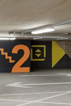 Gallery of Bircham Park Multi Storey Car Park / Architecture + Urbanism - for parking in collective housing block in Valdebebas by SI architects Park Signage, Wayfinding Signage, Signage Design, Parking Signs, Parking Lot, Car Parking, Environmental Graphic Design, Environmental Graphics, Parking Building